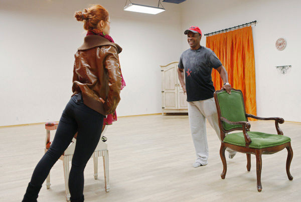 Sugar Ray Leonard, legendary boxer, and partner Anna Trebunskaya balance on some chairs during rehearsal. Season 12 of 'Dancing