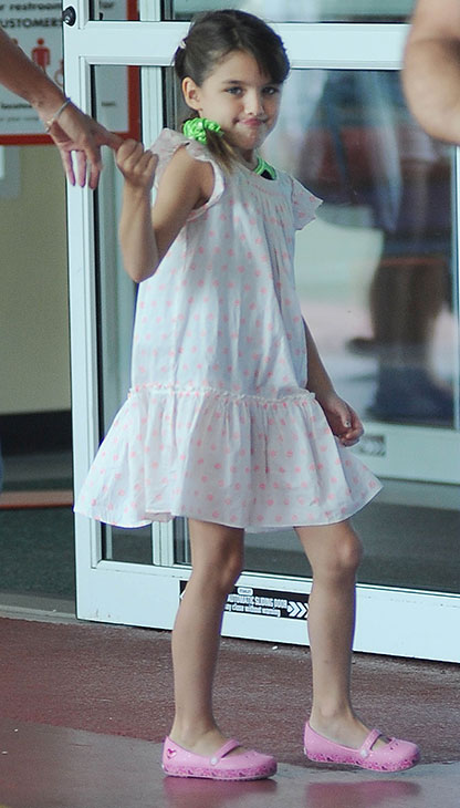 Suri Cruise, 7, is seen on a stroll through Chelsea Piers in New York City on July 15, 2013. Not pictured, her mother, Katie Holmes, who is walking beside her.
