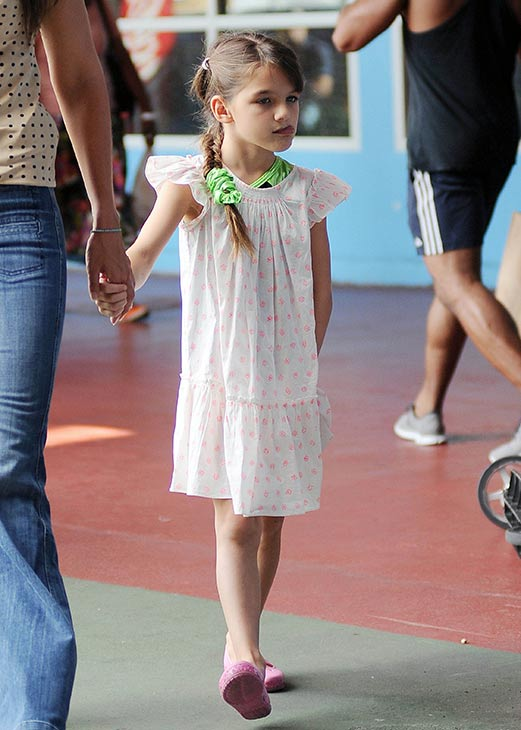 "<div class=""meta ""><span class=""caption-text "">Suri Cruise, 7, is seen on a stroll through Chelsea Piers in New York City on July 15, 2013. Not pictured, her mother, Katie Holmes, who is walking beside her. (Humberto Carreno / startraksphoto.com)</span></div>"
