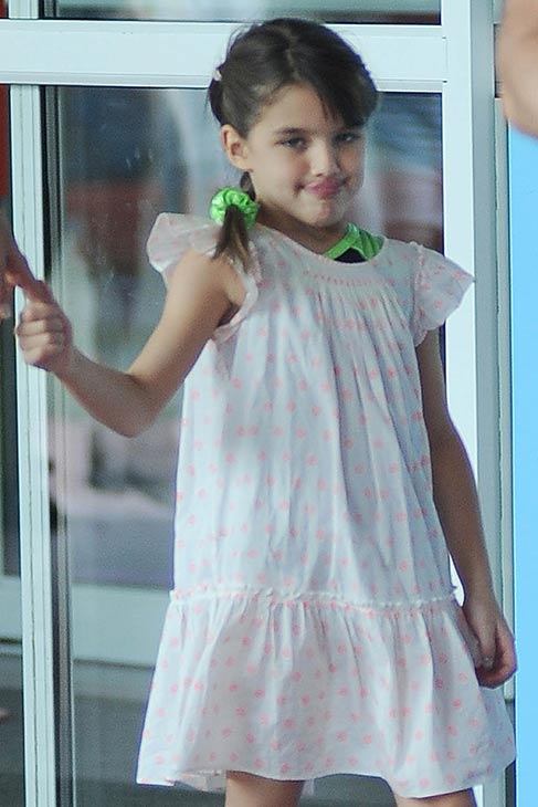 "<div class=""meta image-caption""><div class=""origin-logo origin-image ""><span></span></div><span class=""caption-text"">Suri Cruise, 7, is seen on a stroll through Chelsea Piers in New York City on July 15, 2013. Not pictured, her mother, Katie Holmes, who is walking beside her. (Humberto Carreno / startraksphoto.com)</span></div>"