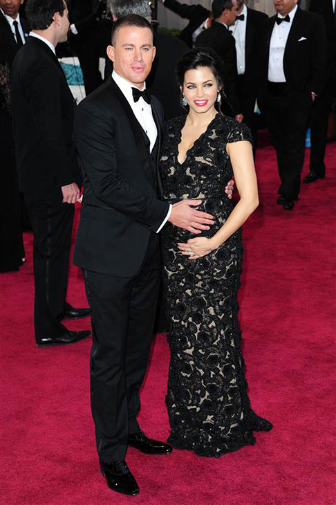 Channing Tatum puts his hand on his pregnant wife Jenna Dewan-Tatum's stomach while appearing on the red carpet at the 2013 Oscars in Los Angeles on Feb. 24, 2013.