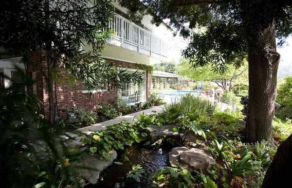 Elizabeth Taylor&#39;s Bel Air home is seen in this photo provided by David Mossler of Teles Properties, Beverly Hills.  The actress bought the some 7,000-square foot, ranch-style house in 1981 and lived there until her death in March 2011 at age 79. The house was put on sale for &#36;8.6 million, it was announced in May 2011. The property contains five bedrooms - including a master bedroom whose walls are painted violet to match Taylor&#39;s signature color, a koi pond and a living room with a beamed ceiling. <span class=meta>(David Mossler&#47; Teles Properties, Beverly Hills &#47; elizabethtaylorestate.com)</span>