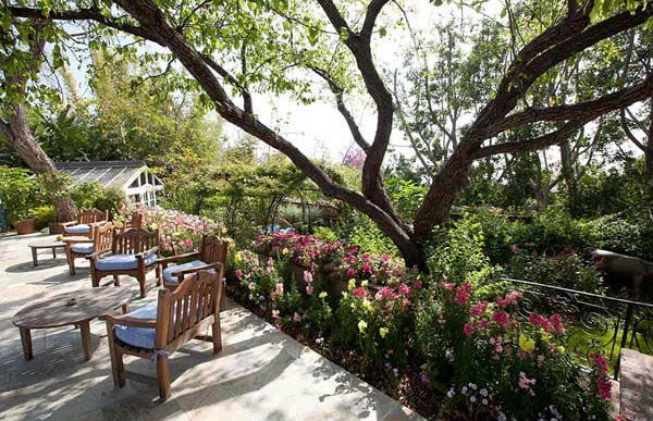 The patio outside Elizabeth Taylor&#39;s Bel Air home is seen in this photo provided by David Mossler of Teles Properties, Beverly Hills.  The actress bought the some 7,000-square foot, ranch-style house in 1981 and lived there until her death in March 2011 at age 79. The house was put on sale for &#36;8.6 million, it was announced in May 2011. The property contains five bedrooms - including a master bedroom whose walls are painted violet to match Taylor&#39;s signature color, a living room with a wood-beam ceiling, a powder room with a sauna and shower and a lawn with flowerbeds, a othouse for orchids and a koi pond with a waterfall. <span class=meta>(David Mossler&#47; Teles Properties, Beverly Hills &#47; elizabethtaylorestate.com)</span>
