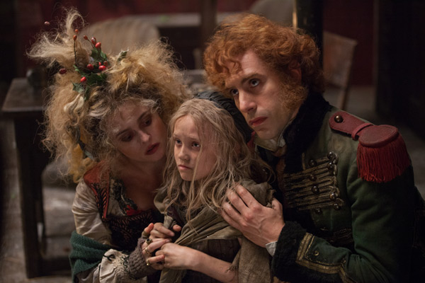 Isabelle Allen appears as young Cosette and Sasha Baron Cohen and Helena Bonham Carter appear as her