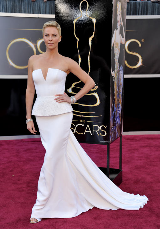 Actress Charlize Theron arrives at the Oscars at...