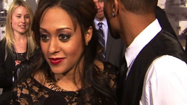Pregnant Tia Mowry of 'Sister, Sister' and husband Cory Hardrict appear at the L.A. premiere of his film 'Battle: Los Angeles' on March 8, 2011.