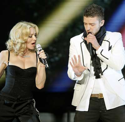 Justin Timberlake and Madonna appear in a photo...