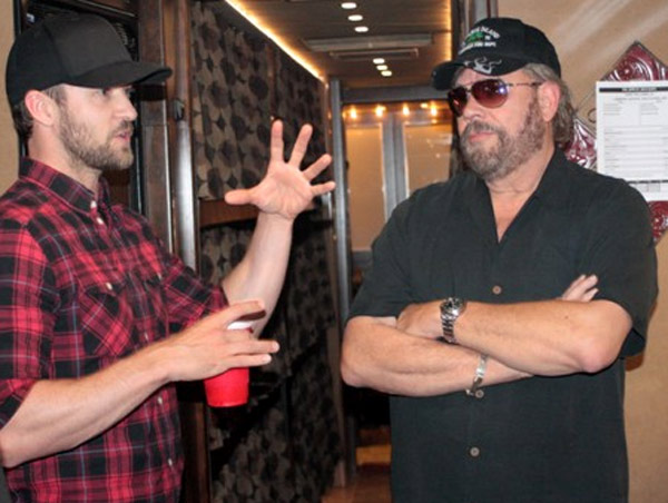 Justin Timberlake and Hank Williams Jr. hang out backstage at Williams concert in Southhaven, Mississippi on April 27, 2012. - Provided courtesy of Hank Williams Jr. / Webster PR