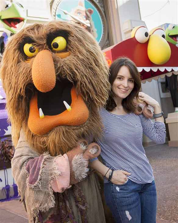 Tina Fey poses with Sweetums from The Muppets at the Walt Disney World Resort in Lake Buena Vista, Florida on March 16, 2014.