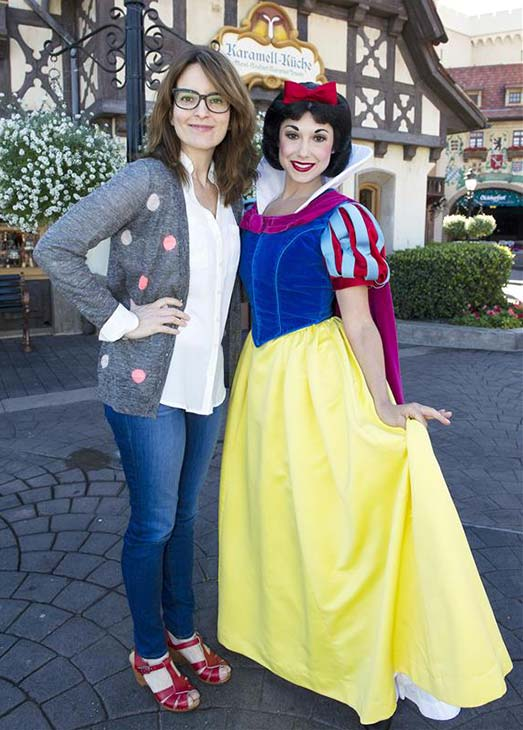Tina Fey poses with Snow White in the Germany pavilion at Epcot at the Walt Disney World Resort in Lake Buena Vista, Florida on Feb. 18, 2013.