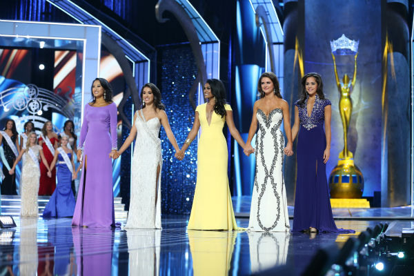 Nina Davuluri, Miss New York (center) and her fellow contestants await their fate at the Miss America 2014 pageant in Atlantic City, New Jersey on Sept. 15, 2013.