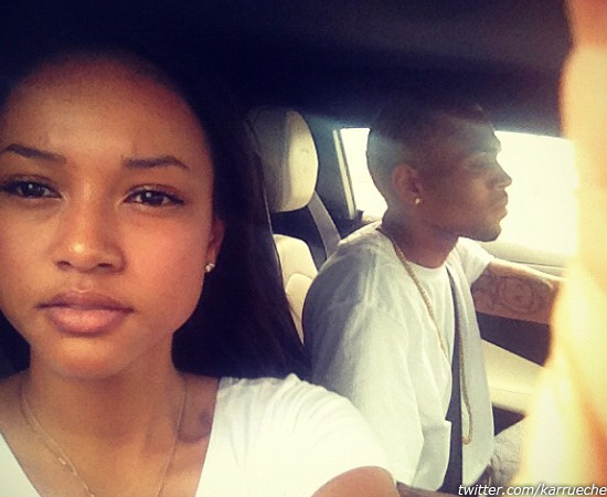 Karrueche Tran and Chris Brown appear in a photo...