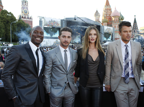From left: Tyrese Gibson, Shia LaBeouf, Rosie Huntington-Whiteley and Josh Duhamel attend a 'Transformers 3: Dark of the Moon' event, which included a Linkin Park concert, in Moscow, Russia on June 23, 2011.
