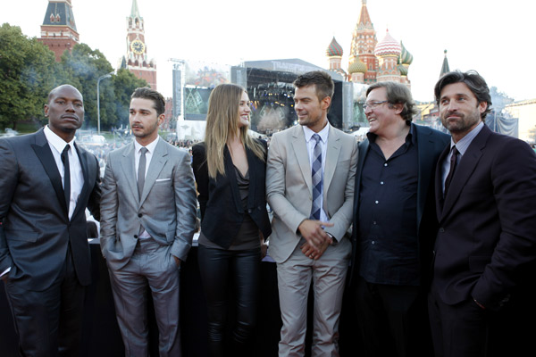 From left: Tyrese Gibson, Shia LaBeouf, Rosie Huntington-Whiteley, Josh Duhamel, producer Lorenzo di Bonaventura and Patrick Dempsey attend a 'Transformers 3: Dark of the Moon' event in Moscow, Russia on June 23, 2011.