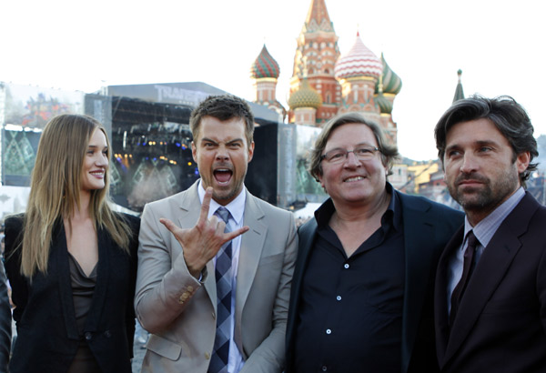 From left: Rosie Huntington-Whiteley, Josh Duhamel, producer Lorenzo di Bonaventura and Patrick Dempsey attend a 'Transformers 3: Dark of the Moon' event, which included a Linkin Park concert, in Moscow, Russia on June 23, 2011.
