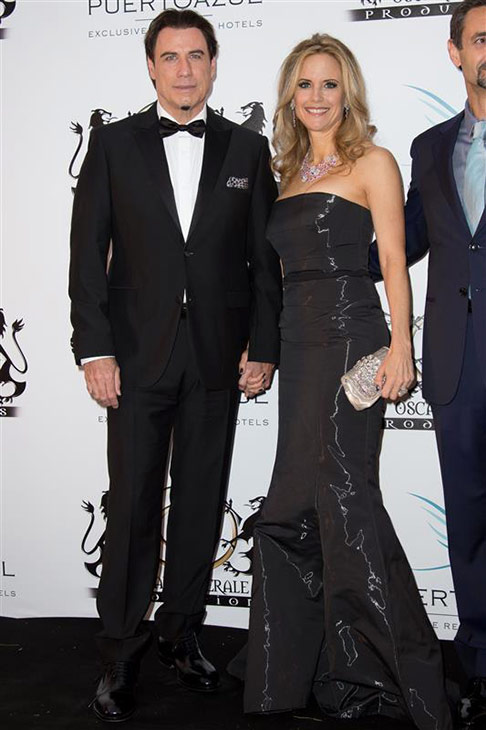 John Travolta and wife Kelly Preston appear at the Puerto Azul Experience Party at the Cannes Film Festival in France on May 21, 2014. <span class=meta>(Nicolas Gouhier &#47; Abaca &#47; Startraksphoto.com)</span>