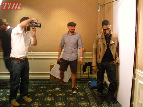 Usher is pictured in a behind-the-scenes photo...