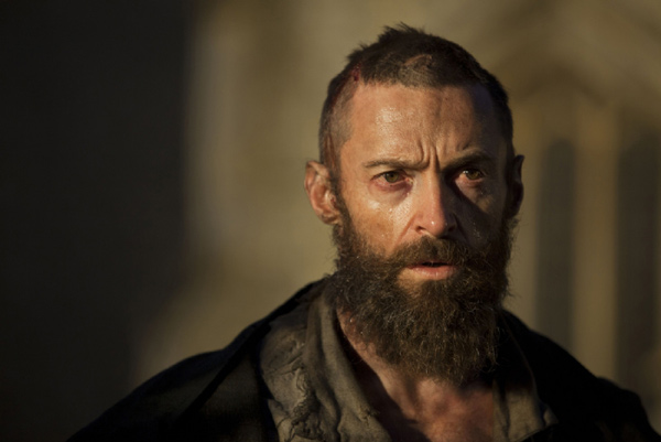 Hugh Jackman appears as Jean Valjean in a scene...