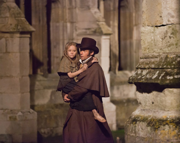 Hugh Jackman and Isabelle Allen appear as Jean Valjean and his adopted daughter Cosette in a scene