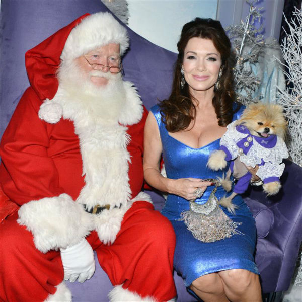 &#39;Real Housewives of Beverly Hills&#39; star Lisa Vanderpump and her dog Giggy pose with Santa Claus for a holiday pet portrait at the Beverly Center shopping mall in Beverly Hills, California on Nov. 14, 2013. <span class=meta>(Tony DiMaio &#47; Startraksphoto.com)</span>