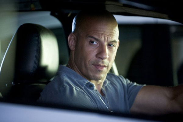Vin Diesel &#40;real name Mark Sinclair Vincent&#41; turns 45 on July 18, 2012. The actor is known for movies such as &#39;xXx,&#39; The &#39;Fast and the Furious&#39; series, &#39;The Chronicles of Riddick&#39; and &#39;Saving Private Ryan.&#39;&#40;Pictured: Vin Diesel appears in a scene from the 2011 film Fast Five.&#39;&#41; <span class=meta>(Universal Pictures)</span>