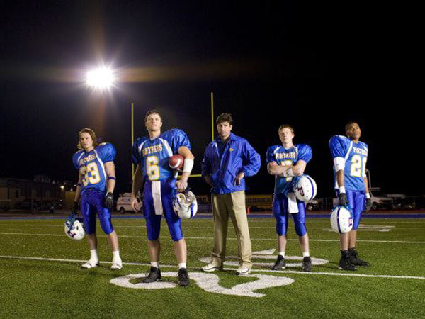 Kyle Chandler, Zach Gilford, Taylor Kitsch, Gaius Charles and Scott Porter in a still from 'Friday Night Lights.'