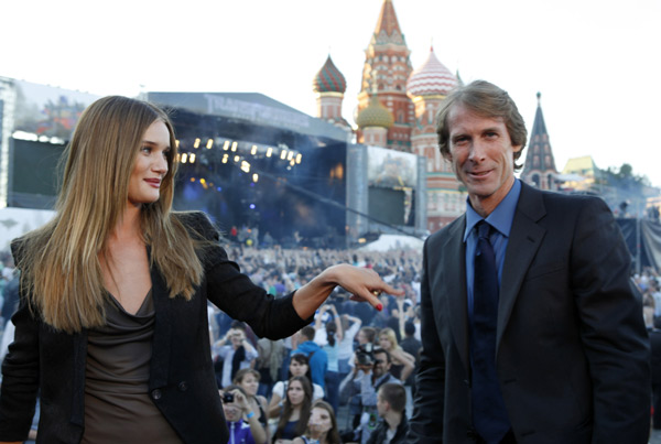 Rosie Huntington-Whiteley and director Michael Bay attend a 'Transformers 3: Dark of the Moon' event, which included a Linkin Park concert, in Moscow, Russia on June 23, 2011.