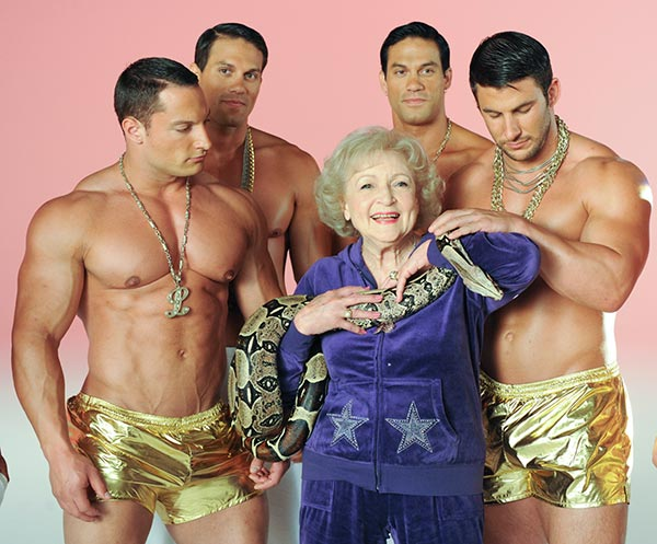 Betty White appears with a group of shirtless men and a red-tailed boa constrictor on the set of her 2011 music video Im Still Hot. - Provided courtesy of The Lifeline Project