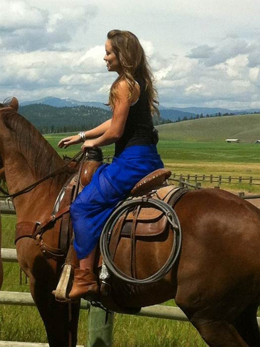 Olivia Wilde says that to keep in shape, she partakes in a spin class, dabbles in karate, participates in yoga and hikes regularly with her dogs, Lola and Paco, according to Women&#39;s Health magazine.&#40;Pictured: Olivia Wilde riding a horse in Montana, as seen in this photo posted on her official Twitter page.&#41; <span class=meta>(twitter.com&#47;oliviawilde)</span>