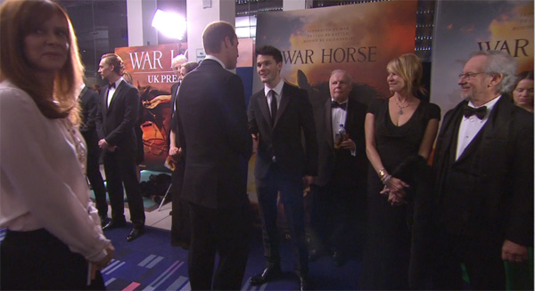 Prince William, the Duke of Cambridge, greets cast member Jeremy Irvine at the UK Premiere of 'War Horse' in London on Sunday, Jan. 8, 2012.