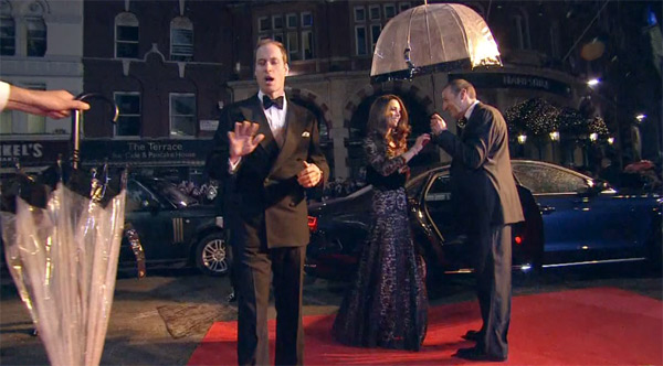 Prince William appears to reject an umbrella, as his wife Kate accepts one on the red carpet of the UK premiere of 'War Horse' in London on Sunday, Jan. 8, 2012.