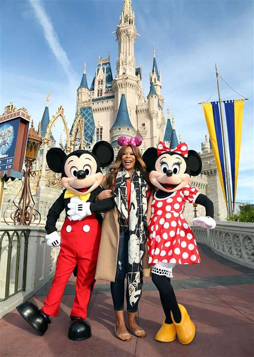 Talk show host Wendy Williams poses with Mickey Mouse and Minnie Mouse at the Walt Disney World Resort in Lake Buena Vista, Florida on Jan. 17, 2014.
