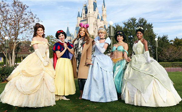 Talk show host Wendy Williams poses with Disney princesses at the Walt Disney World Resort in Lake Buena Vista, Florida on Jan. 17, 2014.
