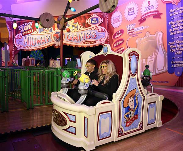 Talk show host Wendy Williams and her son Kevin take a ride on Toy Story Midway Mania! during a visit to Disney's Hollywood Studios theme park at the Walt Disney World Resort in Lake Buena Vista, Florida on Jan. 17, 2014.
