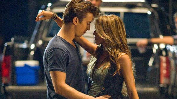 "<div class=""meta image-caption""><div class=""origin-logo origin-image ""><span></span></div><span class=""caption-text"">Julianne Hough's part in the 2011 film 'Footloose,' marks her first leading role.  The movie is a remake of a classic dance-oriented 1984 Kevin Bacon film. Kenny Wormald plays Ren McCormack, who leads a group of teenagers in a small town in the South to rebel against local rules against dancing and rock 'n' roll. Hough plays his headstrong love interest, Ariel Moore, whose father is a minister who leads the anti-dance movement.(Pictured: Julianne Hough appears in a scene from the 2011 film 'Footloose' alongside co-star Kenny Wormald.) (Paramount Pictures / Dylan Sellers Productions / MTV Films)</span></div>"