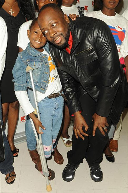 Wyclef Jean poses with a child Haitian amputee at a Kmart store in New York on May 18, 2010. The music artist and the company teamed up to give three young Haitian amputees a thousand-dollar shopping spree. <span class=meta>(Bill Davila &#47; Startraksphoto.com)</span>