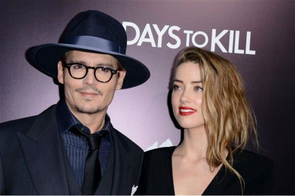 Johnny Depp and reported fiancee Amber Heard, who wore a diamond ring, appear at the premiere of the movie &#39;3 Days To Kill&#39; in Los Angeles on Feb. 12, 2014. It was reported in January that the two are engaged, although the pair has not confirmed this. <span class=meta>(Lionel Hahn &#47; Abacausa &#47; Startraksphoto.com)</span>