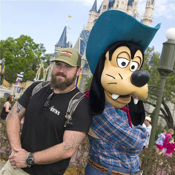 Country music artist Zac Brown, singer/songwriter for the Grammy Award-winning Zac Brown Band, poses with Goofy at the Magic Kingdom part at the Walt Disney World Resort in Lake Buena Vista, Florida on March 18, 2013.