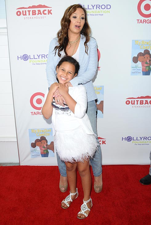 Leah Remini and daughter Sofia Bella Pagan walk the red carpet at the 3rd Annual My Brother Charlie Family Fun Festival in Culver City, California on Aug. 12, 2012.