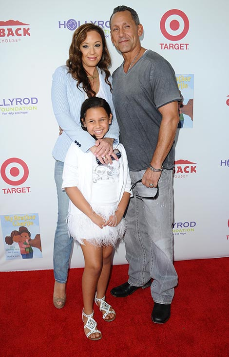 Leah Remini, husband Angelo Pagan and daughter Sofia Bella Pagan walk the red carpet at the 3rd Annual My Brother Charlie Family Fun Festival in Culver City, California on Aug. 12, 2012.