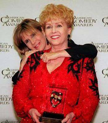 Debbie Reynolds (front) pictured with her daughter Carrie (back).
