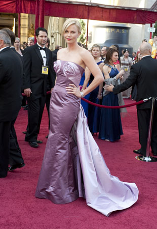 Charlize Theron in a rose pink Diour Haute...