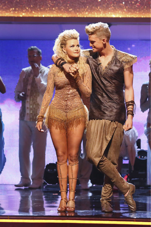 "<div class=""meta image-caption""><div class=""origin-logo origin-image ""><span></span></div><span class=""caption-text"">Cody Simpson and Witney Carson react to being eliminated on week 5 of 'Dancing With The Stars' season 18 -- Disney Night -- on April 14, 2014. They received 34 out of 40 points from the judges for their 'Lion King'-themed Samba. (ABC Photo / Adam Taylor)</span></div>"