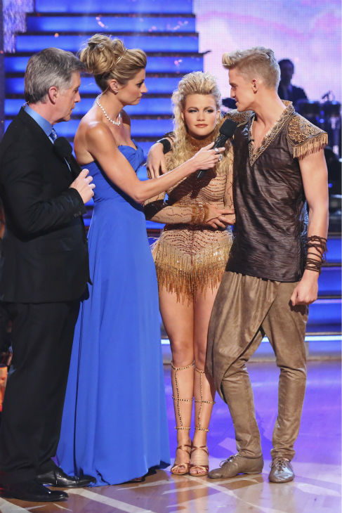 "<div class=""meta ""><span class=""caption-text "">Cody Simpson and Witney Carson react to being eliminated on week 5 of 'Dancing With The Stars' season 18 -- Disney Night -- on April 14, 2014. They received 34 out of 40 points from the judges for their 'Lion King'-themed Samba. (ABC Photo / Adam Taylor)</span></div>"