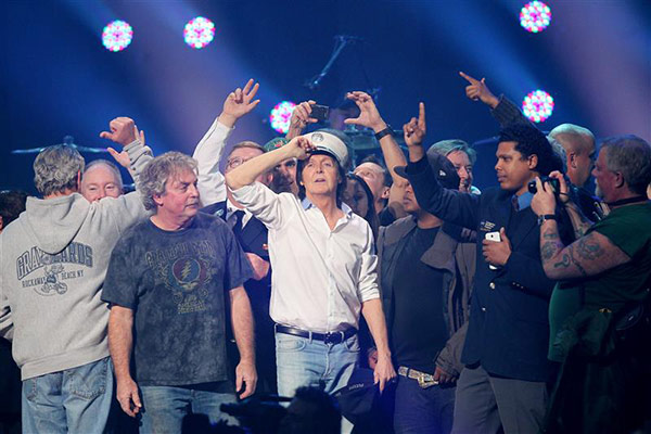 Paul McCartney appears on stage with firefighters during the 12&#47;12&#47;12 Concert for Sandy Relief, benefiting survivors of Hurricane Sandy, in Madison Square Garden in New York on Dec. 12, 2012. <span class=meta>(Dave Allocca &#47; Startraksphoto.ccom)</span>