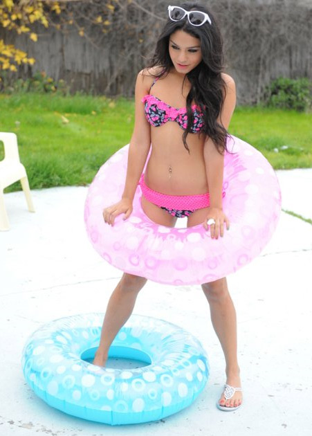 Vanessa Hudgens appears in a 2011 promotional photo taken for the Spring 2011 ad campaign of Candie's apparel, available at Kohl's stores.