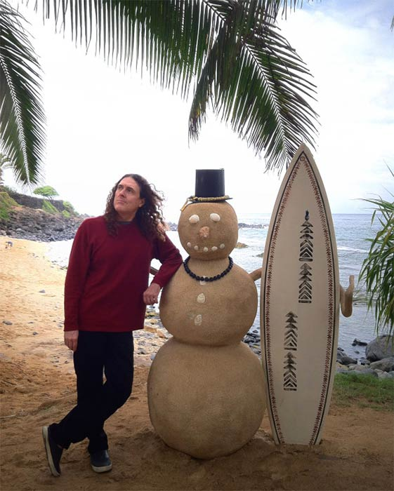 Weird Al Yankovic, singer of parody songs such as &#39;Eat It&#39; &#40;adapted from Michael Jackson&#39;s &#39;Beat It&#39;&#41; and the original track &#39;The Night Santa Went Crazy,&#39; shared this photo of himself on a beach with a &#39;sandman on Dec. 25, 2012, Tweeting: &#39;Mele Kalikimaka, y&#39;all.&#39; <span class=meta>(twitter.com&#47;alyankovic&#47;status&#47;283660339931922432 &#47; twitpic.com&#47;bpbz2a)</span>