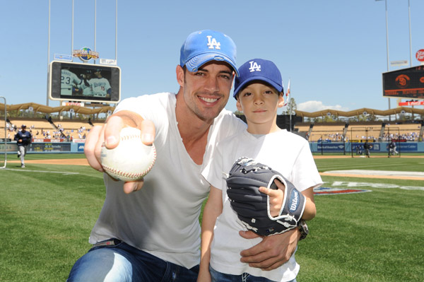 William Levy, a telenovela actor and 'Dancing With The Stars' contestant, and his 6-year-old son Christopher appear at Dodger Stadium to cheer on the Los Angeles Dodgers on April 15, 2012.