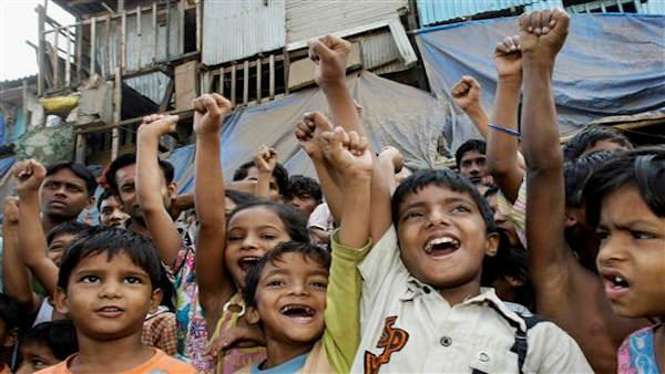 Children of the slum where Slumdog Millionaire actor Rubina Ali lives sing the Oscar winning song Jai Ho from the film in Mumbai, India, Monday, Feb. 23, 2009. Rubina Ali, who is attending the Oscar Awards ceremony, played the youngest version of Latika, in the film which won eight Oscars. (AP Photo/Gautam Singh)