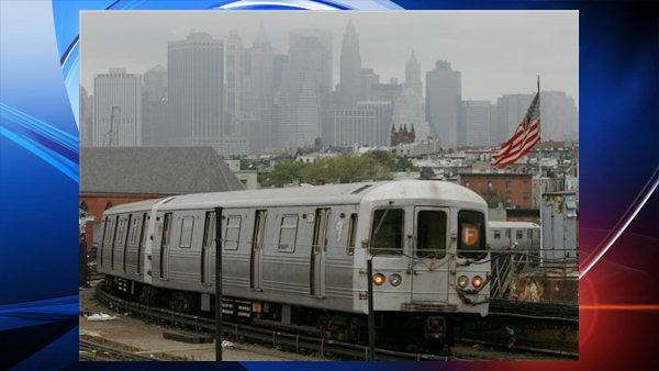 Manhattans downtown skyline is muted in fog as a subway train leaves a Brooklyn station in New York , Friday Oct. 7, 2005. (AP Photo/Bebeto Matthews)